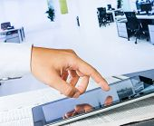 Business Man Touch Digital Tablet On Business Newspaper