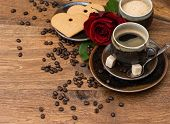 Cup Of Black Coffee With Red Rose