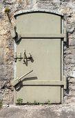 Metal Door In Old Fortification Wall, Background Texture