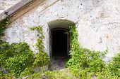 Dark Empty Doorway In Old Fortification Wall, Background Texture
