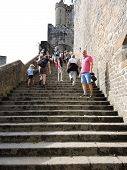 Tourists On Steps To Mont Saint-michel Abbey