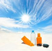 Water And Sun Protection Cream On Sky Background