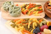 Colorful pasta on wooden background