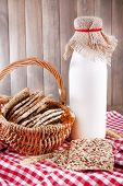Tasty snack in basket on wooden background indoor