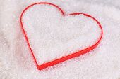 Heart covered in white sugar, close-up
