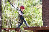 Kid In Adventure Park