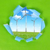 The frame of the green paper. On the background wind turbines.