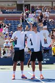 US Open 2014 men doubles champions Bob and Mike Bryan during trophy presentation