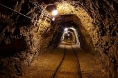 picture of catacombs  - Mining tunnel with lights and rails - JPG