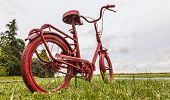 Red Bicycle On The Roadside