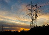 Electrical Power Transmission Towers At Sunrise.