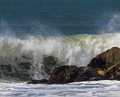 Ocean Surf Breaking Over Jetty