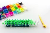 picture of loom  - Close up Colorful of elastic rainbow loom bands in box and tool - JPG