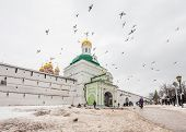 SERGIEV POSAD, RUSSIA - MARCH 20, 2011: Many people visit Trinity Sergius Lavra - largest Orthodox male monastery of Russia, founded in 1337 year. UNESCO World Heritage Site.
