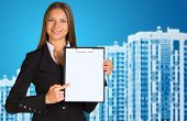 Businesswoman with new houses