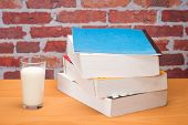 Book For School With Glass Of Milk
