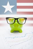 Piggy Bank With Flag On Background - Liberia