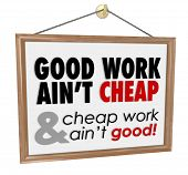 Good Work Ain't Cheap words on a hanging store sign as a motto for great quality service at a fair price