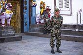 KATHMANDU, NEPAL - DEC 2, 2013: Unidentified guard of King Tribhuwan Memorial Museum in Kathmandu.