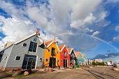 Rainbow Over Buildings In Zoutkamp