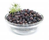 Juniper Berries In A Bowl Over White