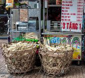 Vietnamese delivery tricycle selling sugar-cane