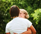 two people hugging outside