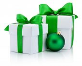 Two White Boxs Tied Green Satin Ribbon Bow And Christmas Ball Isolated On White Background