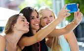 Group Of Friends Taking Selfie In The Street.