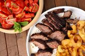 Flank Steak With Fries Onion Rings And Salad