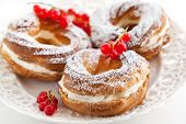 Cream Puff Rings Decorated With Fresh Red Currant
