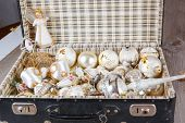 image of weihnachten  - Ancient old white Christmas tree toys in antique suitcase - JPG