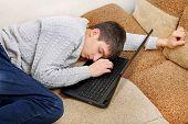 Teenager Sleeps On Laptop