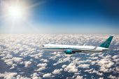 plane flies on the sky and the sun backgrounds