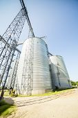 stock photo of silo  - Huge silver shiny agricultural silos during day time - JPG