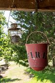 Fire Bucket And Oil Lamp Hanging