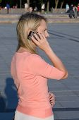 Young Caucasian woman holding mobile phone
