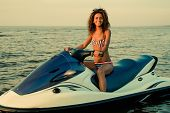 African-american girl sitting on a jet ski