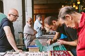People At The Collectible Market Of Stamps And Coins In Plaza Mayor
