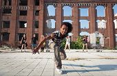 Energetic Street Dancer Lunging At The Camera