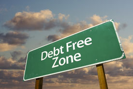 stock photo of debt free  - Debt Free Zone Green Road Sign In Front of Dramatic Clouds and Sky - JPG