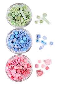 foto of crown green bowls  - Beads in glass bowls isolated on white - JPG
