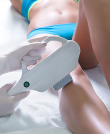 picture of ultrasonic  - Woman getting laser treatment in medical spa center - JPG