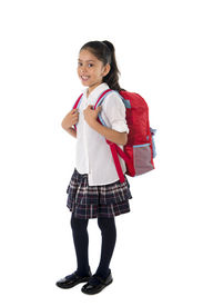 image of schoolgirl  - happy sweet little schoolgirl carrying schoolbag backpack and books smiling in children education and student back to school concept isolated on white background - JPG