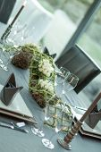 image of centerpiece  - dinner table set with a floral centerpiece - JPG