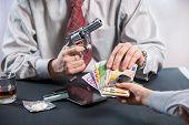 image of loan-shark  - Loan shark with gun - JPG