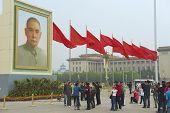 People take photos at Tiananmen Square in Beijing, China.