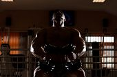 Bodybuilder Doing Heavy Weight Exercise For Chest