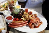 Plate With Sausages And Vegetables
