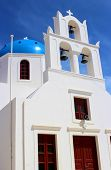 stock photo of blue-bell  - Greek church bells against a deep blue sky in Pyrgos - JPG
